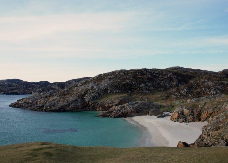 rugged coastline with white beach
