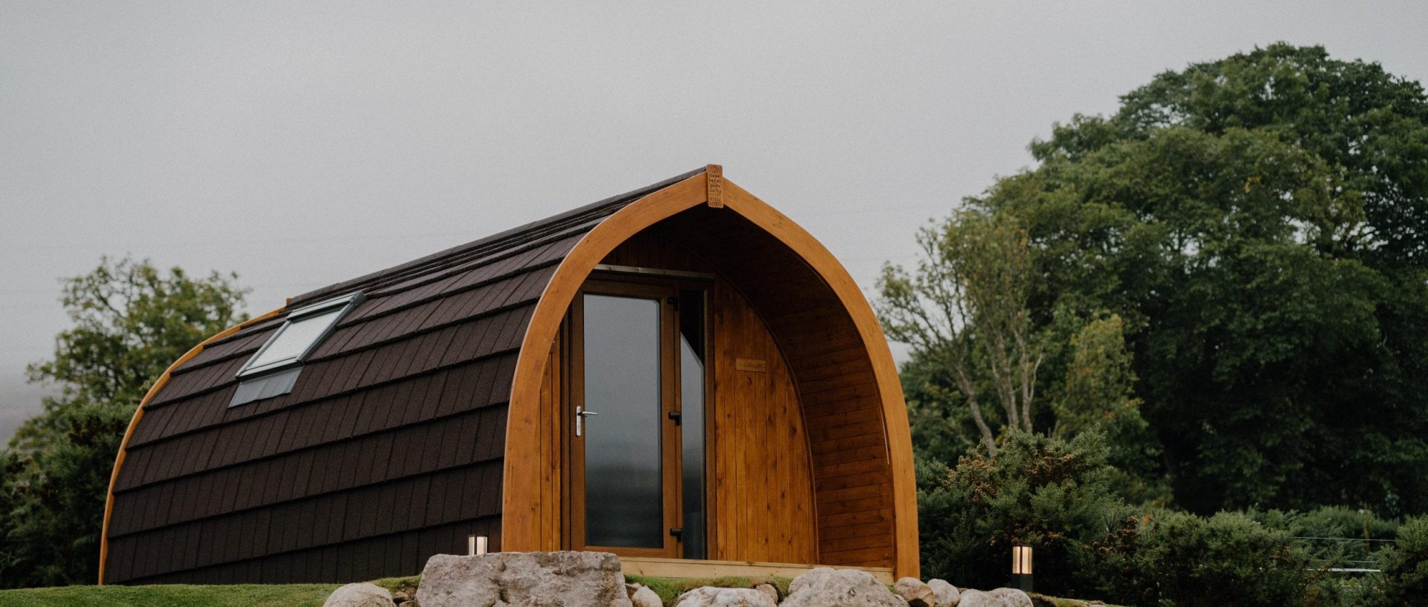 overcast day with glamping pod in foreground